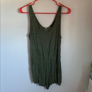 Green romper with black polka dots
